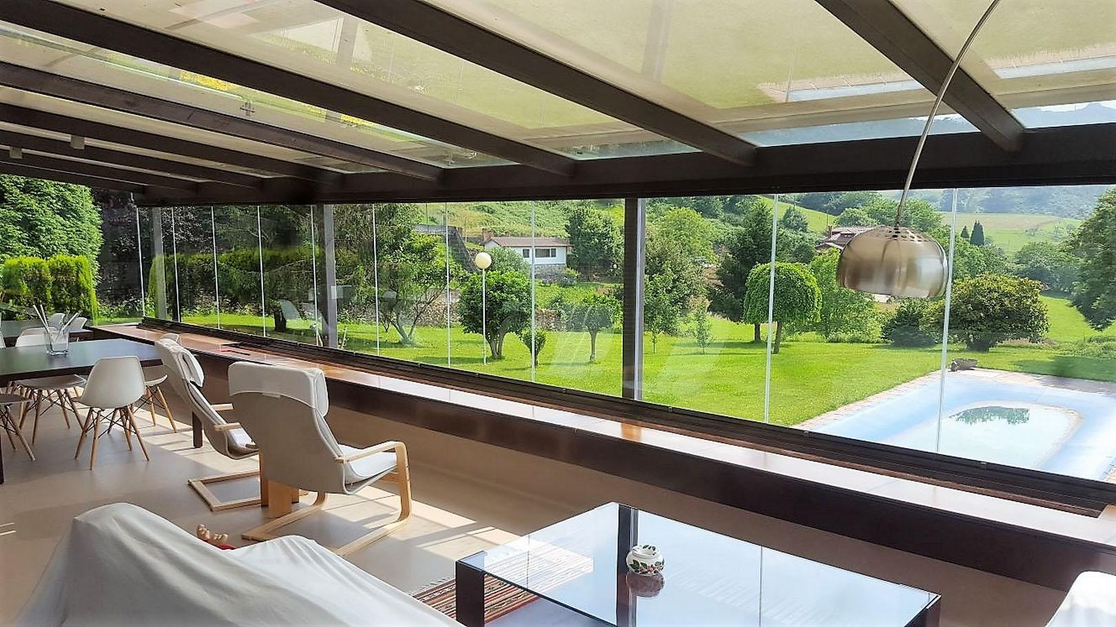 Terraza con cortina de cristal cialca cortinas de for Cortina cristal terraza